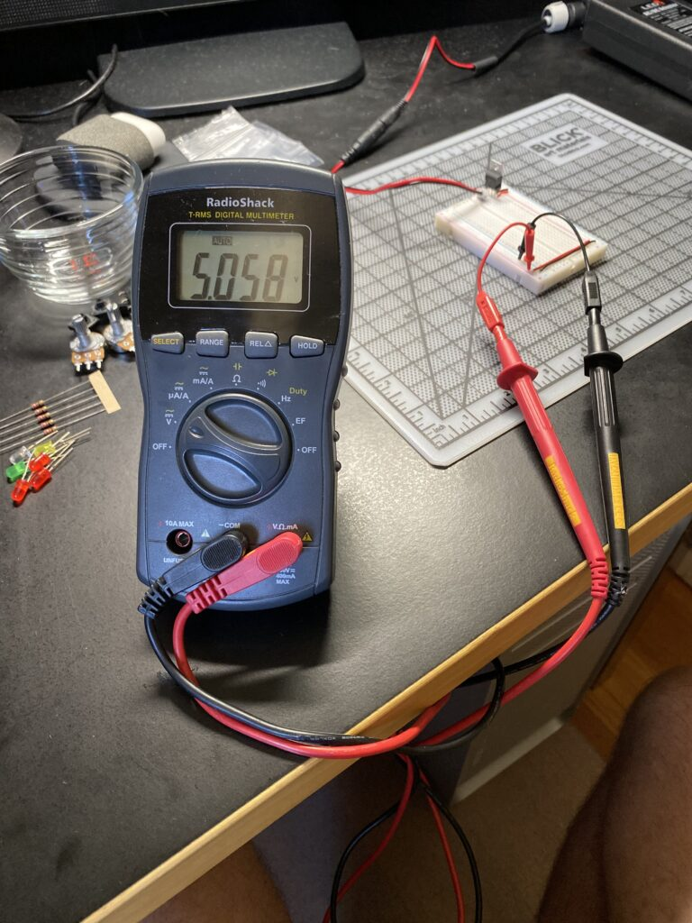 Breadboard setup with multi-meter attached