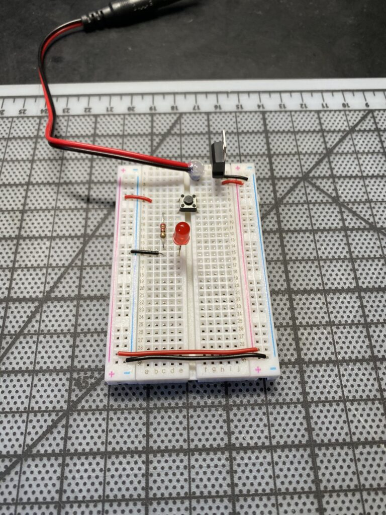 Breadboard with red LED and pushbutton