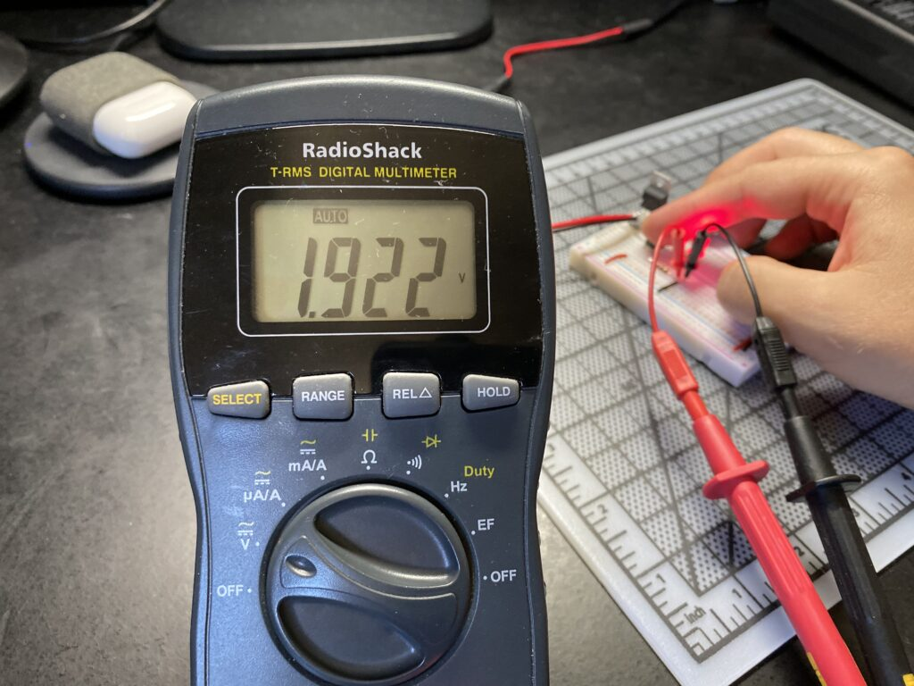 Multimeter reading 1.922 volts voltage drop across a red LED